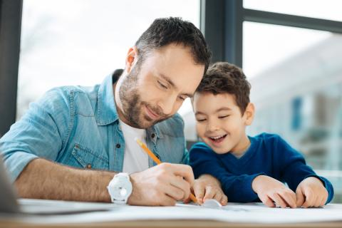 Father and son do homework together.